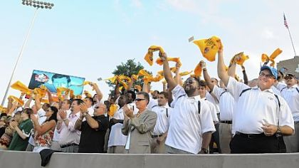 Art Rooney II, Mike Tomlin and Kevin Colbert lead the Steelers as they cheer for LeBeau in the stands in Canton.