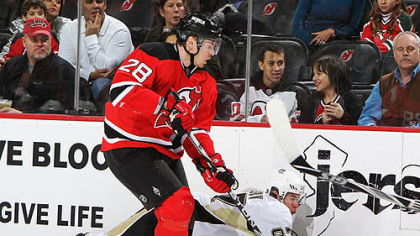 Devils defensman Martin Skoula checks Penguins captain Sidney Crosby in a game earlier this season.