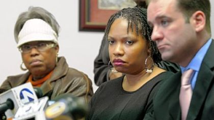 Terez Miles, center, mother of Jordan Miles, who was beaten by three police officers in Homewood, listens during a news conference held by the NAACP on Wednesday. At left is her mother, Patricia Porter, and, at right, her attorney John K. Lewis.