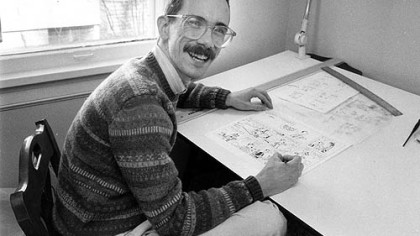 "Bill Watterson works on his cartoon strip ""Calvin and Hobbes"" in 1986. The artist  completely vanished from the public eye when he ended the popular strip in 1995. Nevin Martell will discuss his book about Mr. Watterson at the ToonSeum on Saturday."