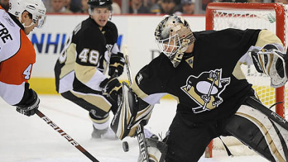 Penguins goaltender Brent Johnson makes save on the Flyers forward Daniel Briere in the second period.