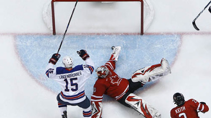 Brian Rafalski, No. 28, scores one of his two goals past Canada's Martin Brodeur.