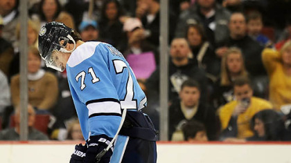 Evgeni Malkin hangs his head after the Nashville Predators tied the score Sunday at Mellon Arena. Nashville won in a shootout, 4-3.