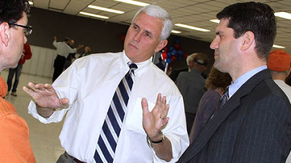 Indiana Congressman Mike Pence, center, makes a point while campaigning on behalf of Republican nominee Tim Burns, right, during a stop Monday in suburban Johnstown. Mr. Burns has enjoyed an upswing in the polls in his quest to succeed the late U.S. Rep. John P. Murtha.