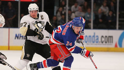 Rangers forward Ryan Callahan controls the puck in front of Penguins forward Sidney Crosby.