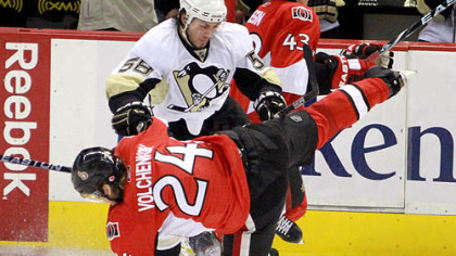Kris Letang checks the Senators' Anton Volchenko in the first period of Game 3, Sunday in Ottawa.