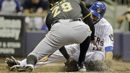 Pirates closer Octavio Dotel tags out the Brewers' George Kottaras at home in the ninth inning Friday.