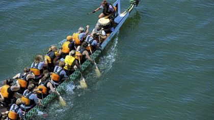 The Women of Steel dragon boat team takes first place Saturday in the 500-meter premier women's race during the Three Rivers Regatta.
