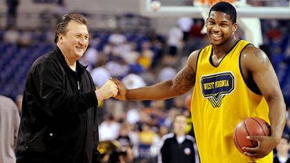 West Virginia head coach Bob Huggins talks with Danny Jennings at Lucas Oil Stadium in Indianapolis at practice yesterday in preparation for their Final Four game against Duke.