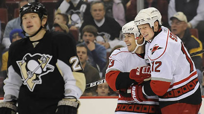 Hurricanes forwards Eric Staal, right, and Ray Whitney celebrate the a goal as Penguins forward Ruslan Fedotenko skates away during a game in December.