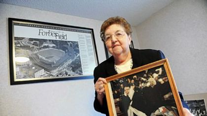 "Alberta Shermann, 80, holds some of the memorablilia from her four decades as a season-ticket holder. She decided not to renew her plan this season. ""They've killed something in me, and I'm done,"" she said."