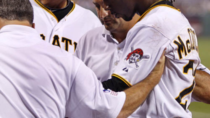 The Pirates' Andrew McCutchen is helped off the field by trainers Brad Henderson, left and Mike Sandoval, center, with manager John Russell, rear, during the second inning.