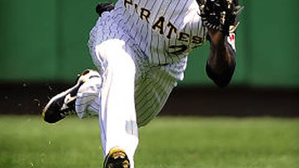 Pirates center fielder Andrew McCutchen makes a diving catch on ball hit by the Astros Pedro Feliz during Sunday&#039;s game at PNC Park. McCutchen was injured on the play.