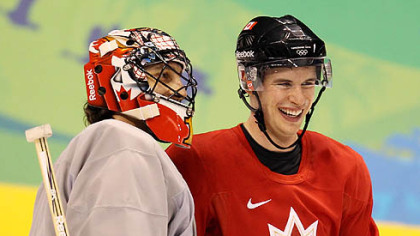 Sidney Crosby, right, and Canada goaltender Roberto Luongo share a laugh during practice Saturday.