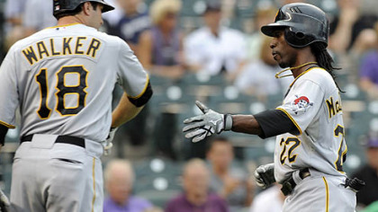 The Pirates' Neil Walker congratulates Andrew McCutchen after McCutchen scored on a single by Jose Tabata in the first inning.