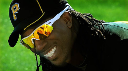 Center fielder Andrew McCutchen has a laugh during a stretch in the grass in Bradenton, Fla.