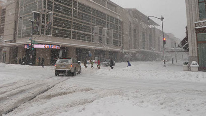 Snow falls on the Verizon Center in Washington today, roughly 24 hours before tomorrow's Penguins-Capitals game.