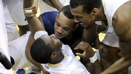 Pitt's Ashton Gibbs is mobbed by teammates after making a last-second shot to win the game.