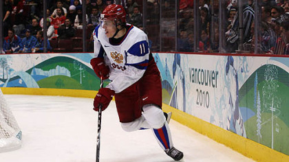 Evgeni Malkin skates with the puck during Russia&#039;s 2-1 loss to Slovakia Thursday.