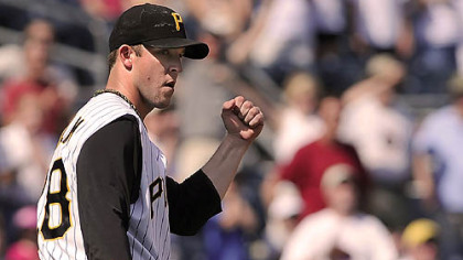 The Pirates' Paul Maholm reacts to a defensive play during his three-hit shutout of Houston Sunday at PNC Park.