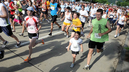 Runners take off for the 5k run in the 8th Annual Father's Day 5k/10k Run and Walk for Prostate Cancer on Sunday.