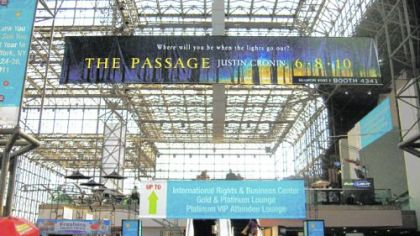 "A banner publicizing ""The Passage"" hangs over BookExpo America in New York last month."