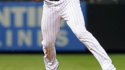 Rockies shortstop Troy Tulowitzki bobbles a ground ball hit by the Pirates' Jose Tabata in the sixth inning.