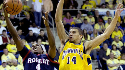 Robert Morris' Karon Abraham goes for the layup while Quinnipiac's James Feldine defends during the second half.