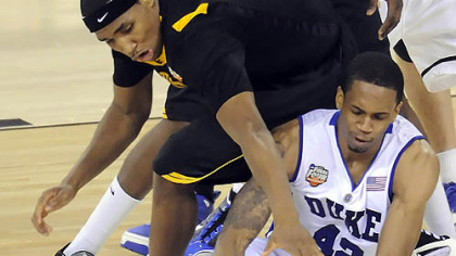 Duke's Lance Thomas grabs a loose ball in front of West Virginia's Kevin Jones in the second half of the semifinal game in the NCAA tournament in Indianapolis last night.
