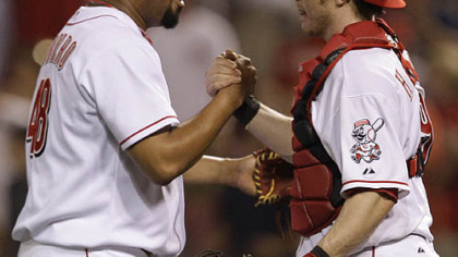 Reds relief pitcher Francisco Cordero is congratulated by catcher Ryan Hanigan after beating the Pirates.