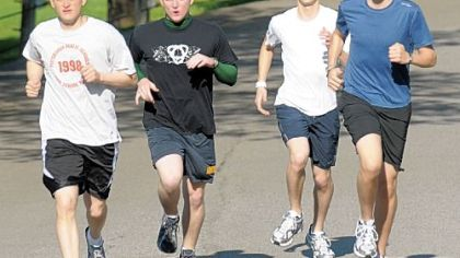 Seminarians, from left, William Wuenschel, Benjamin Cahill, Anthony Sciarappa and Patrick Caruso will be running in Sunday's Pittsburgh Marathon to raise money for people who need to pay college loans before joining religious orders and taking vows of poverty.