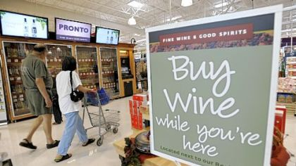 Shoppers walk past the wine selection offerings from the Pennsylvania Liquor Control Board&#039;&#039;s self-serve wine kiosk at a Giant food store in Harrisburg, Pa.
