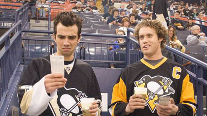 Kirk (Jay Baruchel, left) works as a TSA agent with former high school buddy Stainer (T.J. Miller, right). Here, they're seen in Mellon Arena at a Penguins game.