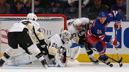 Penguins goaltender Marc-Andre Fleury and forward Sidney Crosby defend the net against Rangers forward Ryan Callahan.