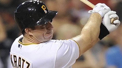 The Pirates' Erik Kratz singles in the fifth inning for his first major-league hit.