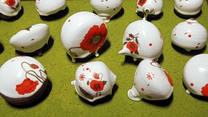A detail of ceramist Kyle Houser&#039;s &quot;Poppy Field.&quot;