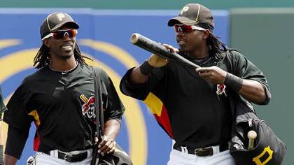 Pirates outfilenders Andrew McCutchen, left, and Lastings Milledge walk to the dugout before the game.