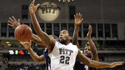 Pitt guard Brad Wanamaker goes for a rebound against Robert Morris in the first half.