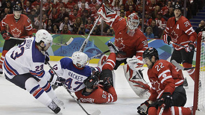 Chris Drury, left, slams home a shot into Canada's vacated net. Only defenseman Dan Boyle had a chance to stop him.