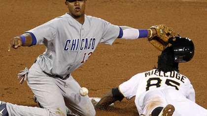 The Pirates' Lastings Milledge steals second base in the eighth inning as the ball gets away from Cubs shortstop Starlin Castro.