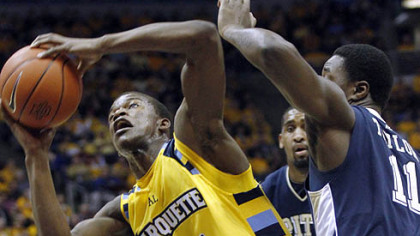 Marquette&#039;&#039;s Jimmy Butler, left, drives to the basket against Pittsburgh&#039;&#039;s Dante Taylor, right, in the first half of an NCAA college basketball game, Thursday, Feb. 18, 2010, in Milwaukee. (AP Photo/Darren Hauck)
