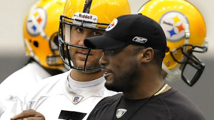 Steelers quarterback Ben Roethlisberger listens to head coach Mike Tomlin.