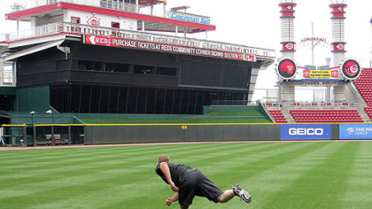 Pirates reliever Evan Meek works out alone before a May 25 game in Cincinnati, throwing a phantom pitch, then sprinting 30 yards, then repeating twice