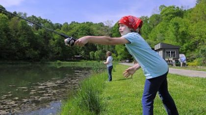 Genevieve Moffett, 6, practices casting off as she fishes for blue gill May 20 at a private lake in Bell Acres that is open to the Fern Hollow Nature Center. The Fern Hollow Nature Center in Sewickley was awarded a grant to develop a youth and family fishing program.