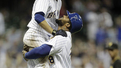 The Brewers' Prince Fielder lifts teammate Ryan Braun after Braun got a game-winning hit during the 10th inning.