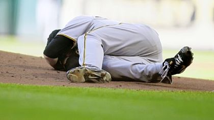 Pirates pitcher Chris Jakubauskas lays on the mound after being hit in the face with a line drive off the bat of Lance Berkman in the first inning at Minute Maid Park on Saturday in Houston.