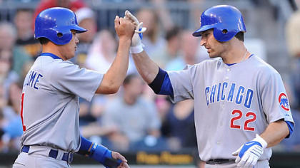 The Cubs' Xavier Nady, right, is greeted at home by Kosuke Fukudome after hitting a two-run homer off Pirates pitcher Jeff Karstens in the third inning.