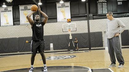 The Spurs&#039; DeJuan Blair works on his free throws under the watch of assistant coach Chip Engelland at his team&#039;s practice facility in San Antonio.