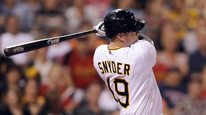 Chris Snyder hits a three-run home run against the Rockies in the sixth inning Saturday night.