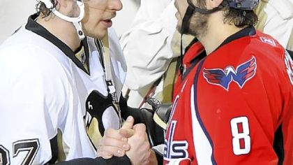 Penguins forward Sidney Crosby shakes hands with Capitals forward Alex Ovechkin following  Game 7 of last seasons&#039;s Eastern Conference semifinal at the Verizon Center in Washington.